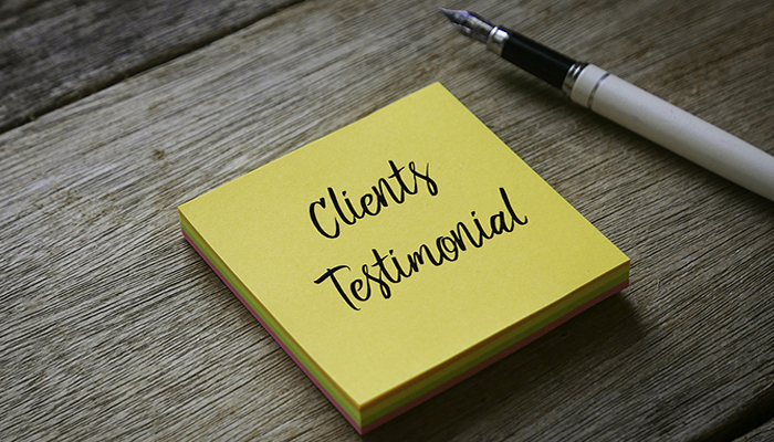 "yellow post it note with ""client testimonials"" written on it"